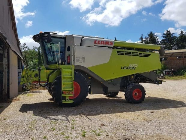 moissonneuse batteuse en intercuma Claas Lexion 670